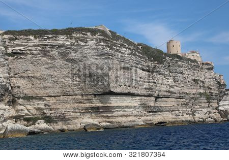 Cliffs Of Bonifacio Town In The Corsica Island In Mediterranean Sea And A Lokkout Tower