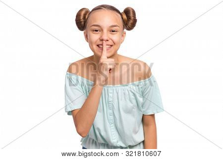 Teen girl asking to be quiet with finger on lips, isolated on white background. Cute young teenager making keep Quiet gesture. Child asking for silence or secrecy with finger on lips shh sign symbol.
