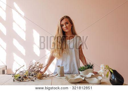 Portrait Of Young Woman Ceramist Standing In Her Studio