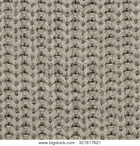The Texture Of The Knit Fabric Is Beige. Abstract Background. Close-up.