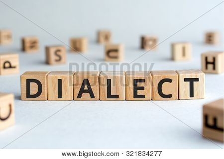 Dialect - Word From Wooden Blocks With Letters, Form Of A Language Dialect Concept, Random Letters A