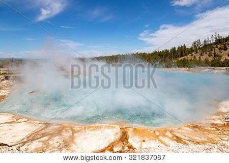 Steam Rises From A Pool At Grand Prismatic Spring In Yellowstone National Park. It Is The Largest Ho