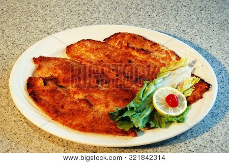 Dish Of Broiled Filet Of Flounder As Served In A Diner Or Restaurant
