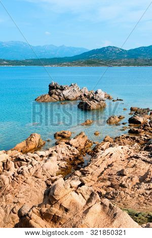 a view of the rock formations in La Tonnara, on the Southern coast of Corsica, France, and a calm Mediterranean sea