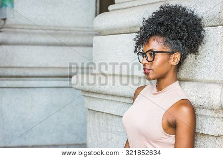 Portrait Of Young African American Woman In New York. Young Black Female College Student With Afro H