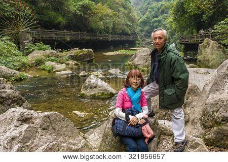 Happy Asian Senior Couple Having Vacation In China
