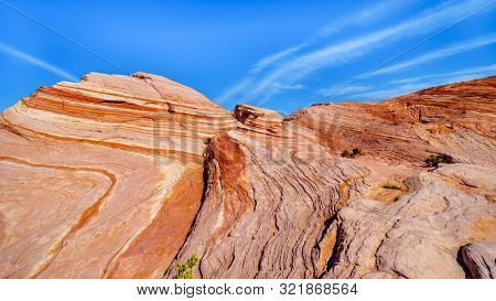 The Colorful Red, Yellow And White Banded Rock Formations Of The Fire Wave Rock On The Fire Wave Tra