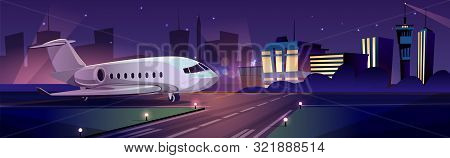 Private Passenger Plane Or Personal Business Jet On Runway At Night, Airport Terminal Building On Ba