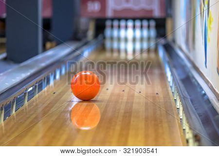 Bowling Ball On Alley In Indoor Bowling Club