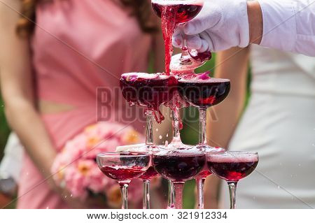 Wedding Party: Guests Clink Glasses Of Champagne. Hand Closeup