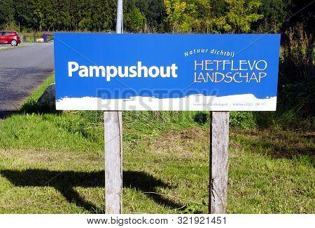 Almere, The Netherlands - September 13, 2019: Entrance Sign Of Flevo-landschap Het Pampushout.