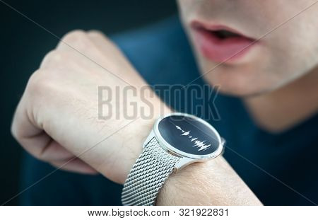 Voice Recording Or Speech Recognition Technology In Smart Watch. Man Talking To Smartwatch Mic And R