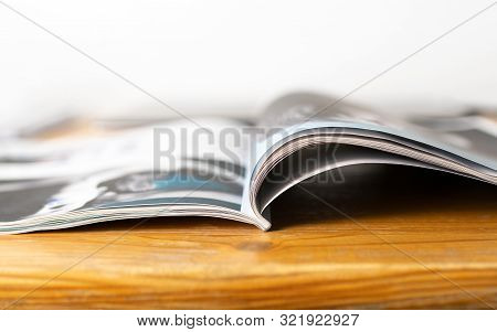Magazine On Wooden Table. Beauty Or Fashion Tips And Trends. Open Page With News Article, Column Or