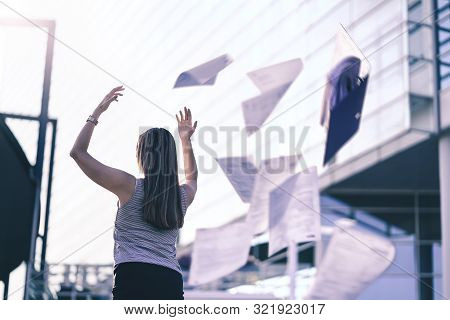 Business Woman Throwing Work Papers In The Air. Stress From Workload. Person Going Home Or Leaving F