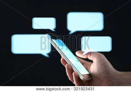 Text Messages In Cellphone Screen With Abstract Hologram Speech Bubbles. Instant Messaging App. Text