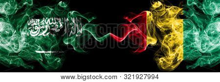 Saudi Arabia Kingdom Vs Guinea, Guinean Smoky Mystic Flags Placed Side By Side. Thick Colored Silky