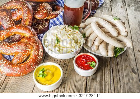 Bavarian German Holiday Traditions. Oktoberfest Food And Beer Glass Mug. Background For Congratulati