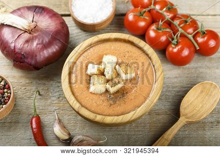 Vegetable Cream Soup Puree In A Plate On A Rustic Wooden Background. Next To Vegetables And Spices