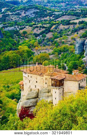 Monastery On Cliff In Meteora, Monastery Of Rousanou, Thessaly Greece. Greek Destinations