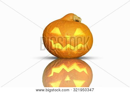 A Nasty Grinning Halloween Pumpkin On Isolated Background