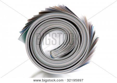 Magazine rolled up on white background
