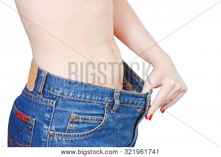 Woman Showing How Much Weight She Lost. Healthy Lifestyles Concept