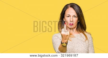 Beautiful middle age woman wearing fashion sweater Showing middle finger, impolite and rude fuck off expression