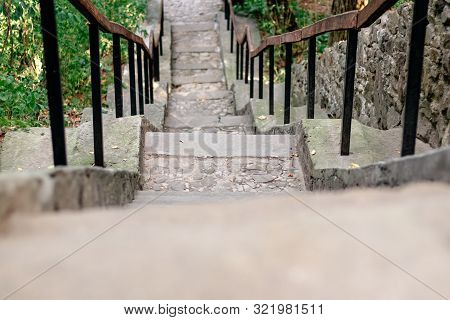 Cement Staircase Goes Up The Slope In A Green Forest
