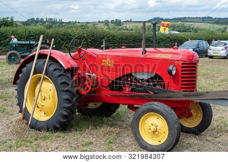 Haselbury Plucknett.somerset.united Kingdom.august 18th 2019.a Massey Harris Tractor Is On Display A