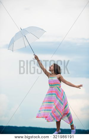 Dreaming about first flight. Kid pretending fly. I believe i can fly. Touch sky. Girl with light umbrella. Fairy tale character. Happy childhood. Feeling light. Anti gravitation. Fly drop parachute poster