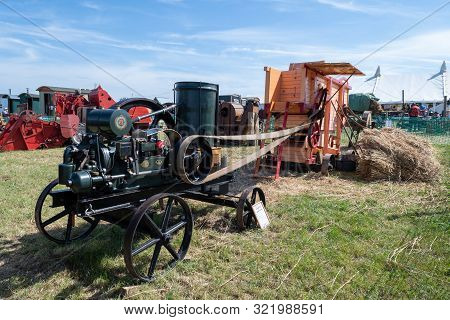 Blandford Forum.dorset.united Kingdom.august 24th 2019.a Threshing Machine Is Being Driven By An Ant
