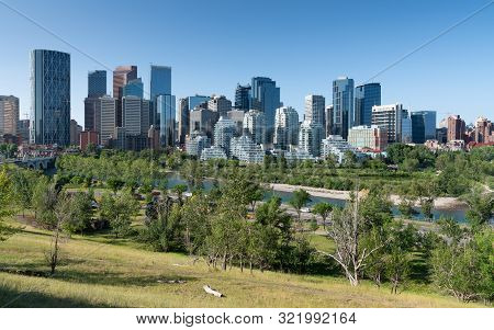 Calgary, Canada - August 5, 2019: Panoramic Image Of The Skyline Of Calgary On A Sunny Day With Blue