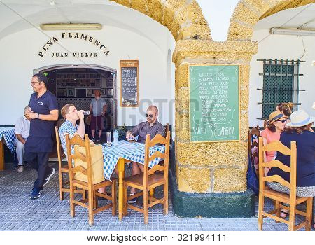 Cadiz, Spain - June 23, 2019. Tourists Refreshing On A Terrace Of A Tavern At Cadiz Downtown, Offeri