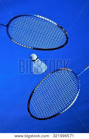 Racquets And A Flying Shuttlecock For Badminton. Players Rivals Summer Recreation, Spectacular And A
