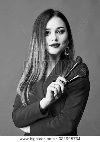 poster of Gorgeous lady makeup red lips. Attractive woman applying makeup brush. Strengthen confidence with bright makeup. Perfect skin tone. Makeup artist concept. Looking good and feeling confident