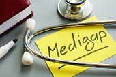 Medigap or medicare supplement insurance inscription and stethoscope. poster