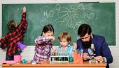 Explaining chemistry to kids. Fascinating chemistry lesson. Man bearded teacher and pupils with test tubes in classroom. Observe reaction. Science is always the solution. School chemistry experiment poster