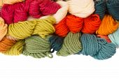 pile of woolen yarns isolated on white background poster