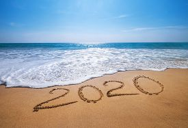 Happy New Year 2020 Is Coming Concept Sandy Tropical Ocean Beach Lettering. Exotic New Year Celebrat