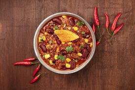 Chili Con Carne, A Mexican Stew With Red Beans, Cilantro Leaves, Ground Beef, And Chili Peppers, Sho