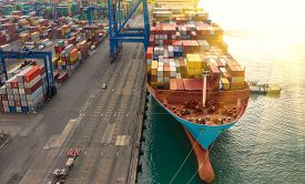 Container Ship In Export And Import Business Logistics And Transportation. Cargo And Container Box S