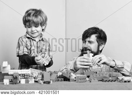 Dad And Kid Build Of Plastic Blocks. Useful Toy. Child Care Development And Upbringing. Father Son G