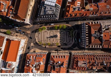 Top Down View Of Town Square In Lisbon, Portugal. Decorative Tiled Ground With Ornaments And Statue
