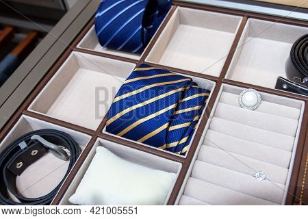 Mens Accessories In The Closet Drawer: Leather Strap, Necktie