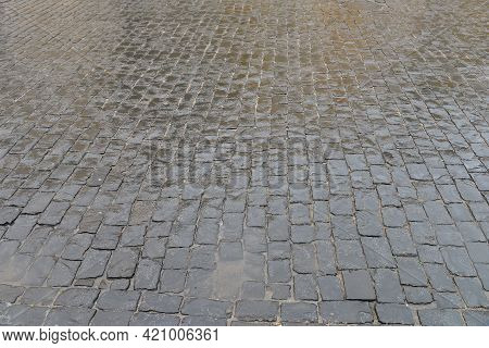 Abstract Background. Old Cobblestone Pavement Close Up.