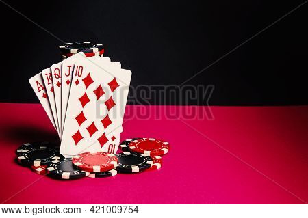 Poker Cards With Royal Flush Combination. Close-up Of Playing Cards And Chips In Poker Club. Free Ad