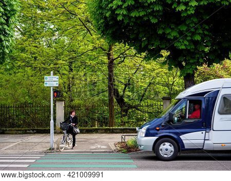 Strasbourg, France - May 2, 2020: Woman With Bike Waiting To Cross The Street At Red Light With Rv C