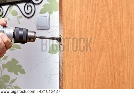 Locksmith Use A Flat Bit To Wood When Drilling A Hole For Latch.