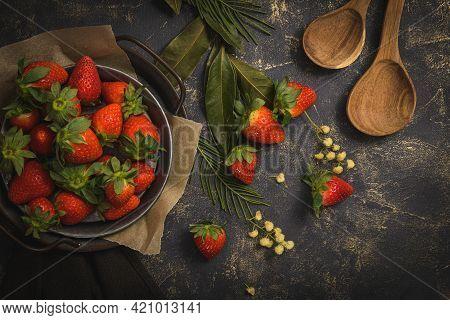 Fresh Strawberries On Round Metal Plate On A Dark Background.