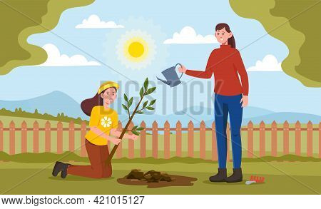 Mom And Daughter Are Planting Plants And Trees In The Garden. Smiling Mother And Her Daughter Are Sp